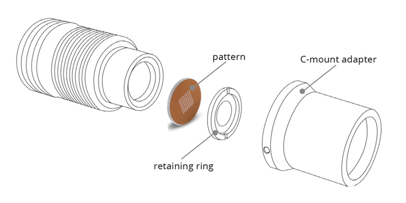 Pattern projector with circular aperture disassembled.
