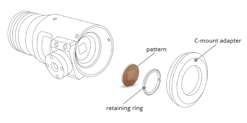 Pattern projector with square aperture disassembled.